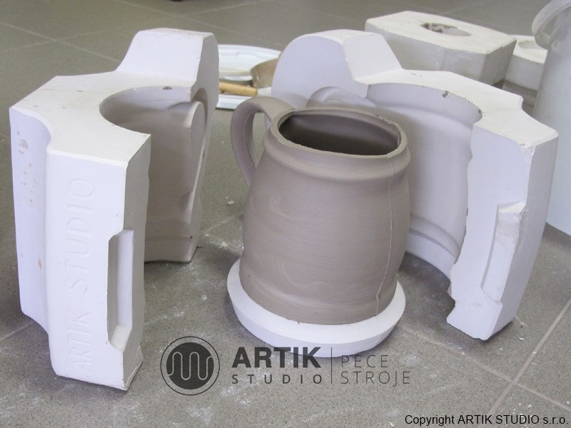 Plaster moulds for cast ceramics - a sample of a cup cast.